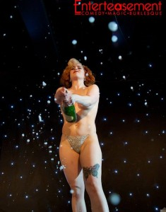 Tilly Tassle Burlesque act with champagne